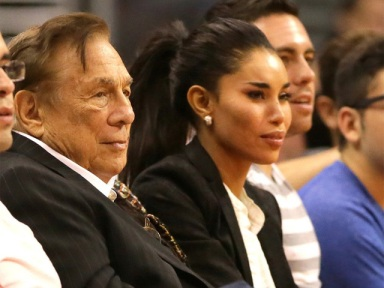 Donald Sterling and V. at a Clippers game.