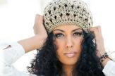 Portrait of young black woman wearing wool cap