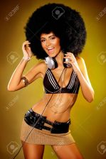 6565534-beautiful-woman-with-huge-afro-haircut-color-wall-stock-photo-afro-dj-girl